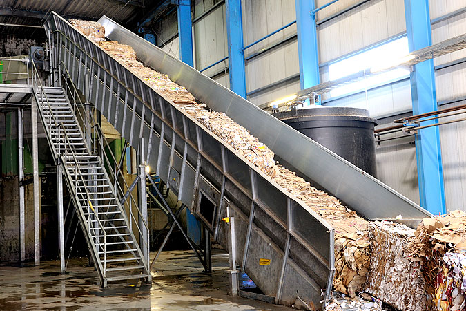 Conveyor belt waste paper